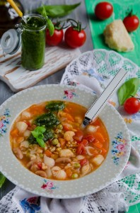 Traditional italian soup minestrone with pesto sauce