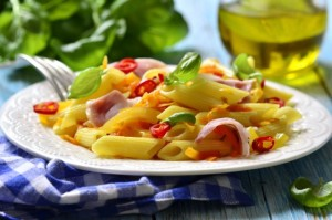 Penne with fried vegetable and smoked bacon.