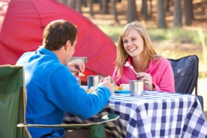 Couple Enjoying Meal On Camping Holiday
