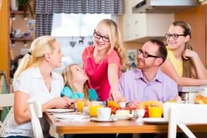 Family having joint breakfast in kitchen