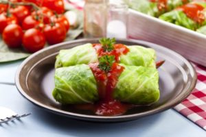 cabbage stuffed with rice and meat on plate